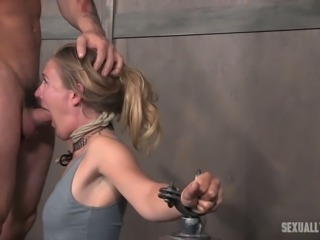Blonde slender white lady shackled to the posts and facefucked