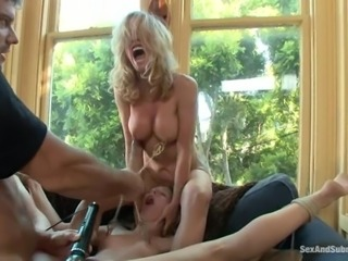 Two tied up blonde chicks fist their asses and get fucked