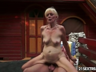 This raunchy granny really knows how to ride a dick