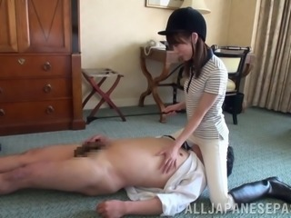 Sizzling Asian dominatrix with a skinny body spanking a stranger