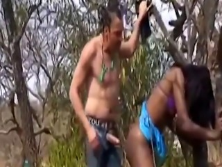 Outdoor nipple torment and doggy style fucking with African slut