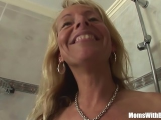 Blonde Cougar Shaving In The Shower Blows Cock