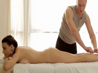 Adorable babe cockriding on the massage table