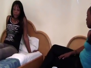 Lesbian sex with hot and busty African sluts inside the bedroom