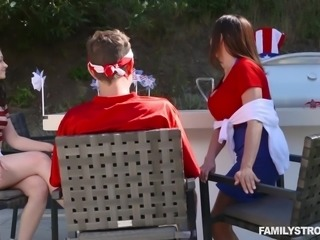 It's the Fourth of July and Ariella has her massive boobs out. She wraps them...