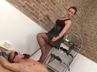 Eliza playing with her obedient male slave and giving him a footjob