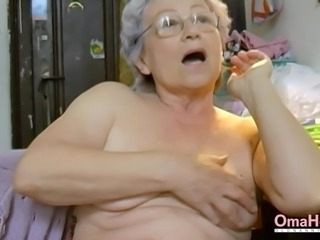 Amateur grandma is playing naked with her hairy pussy and favourite toy