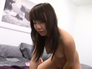 After giving head nice cute Asian brunette Lei Lani rides stiff dick on top