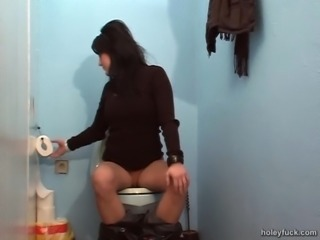 Sweater girl at the gloryhole gladly makes his cock cum