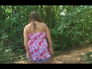 Busty and delicious white sexy girl outdoors flashes her goodies