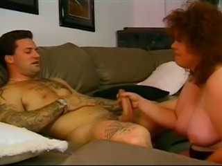 Perverted curly haired BBW redhead gives a BJ and rides fat prick