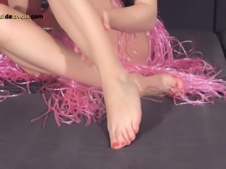 Flashy Italian solo model massages her cute feet in close up shoot