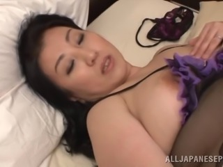 Japanese BBW Fujiko Minegishi lays back and rubs her pussy