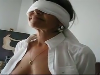 Blindfolded mature housewife exposes her rather ugly tits on camera