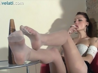 She flashes her red hot feet while relaxing and smoking