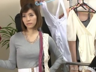 Japanese bitch pretends to be a dummy and gets her tits licked