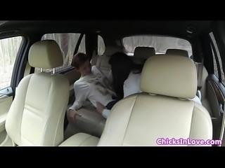 Classy lesbian fingering pussy in her car