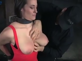 Awesome busty Rylie Kay gets to know what breast bondage is about