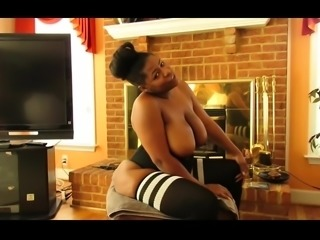 Fat ebony lady has a black rod plowing her pussy from behind