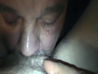 Licking her hairy pussy
