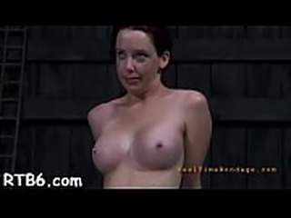 Fastened and tossed up hotty receives toy pleasuring for her twat