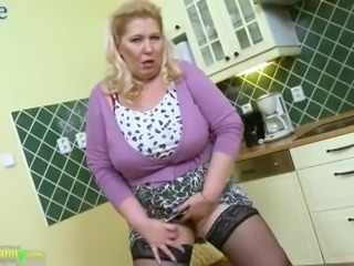 Fat mature whore plays with her giant boobs and teases her clit a bit too