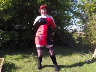 Harley Quinn Cosplay flashing outdoors