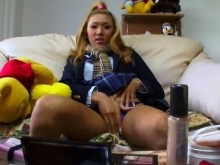Sexy and feminine Japanese tgirl masturbates for camera