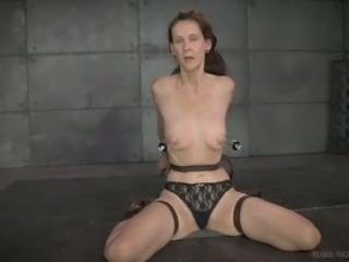 Slim brunette mature with tiny pumps on her nipples likes to be tortured