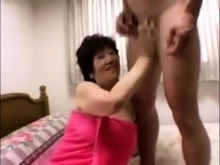 Wild Japanese granny has sex with her young lover on the bed