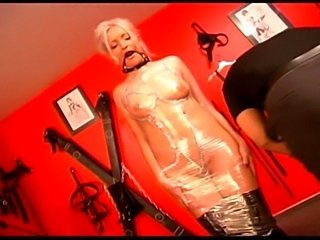 Sweet fem dom and willing slaves collude in this Germanfetish feature....