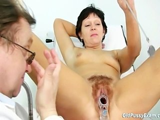 Mature hairy pussy Eva being gyno speculum examined on gynochair