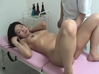 Young Wife comes to a local spa to get stress relaxation massage. The...